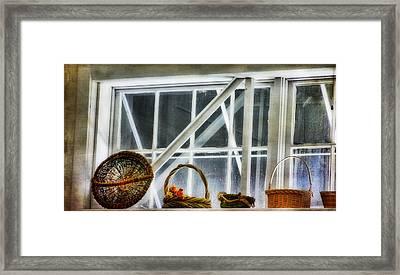 Baskets In The Window Framed Print by Joan Bertucci