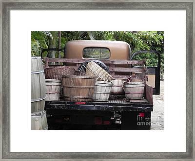 Baskets Of Feed Framed Print by Chrisann Ellis