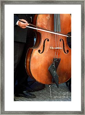 Bass Player In The Prague Funfair Band Framed Print by James L. Amos