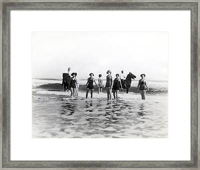 Bathers And Horses In The Surf Framed Print by Underwood & Underwood