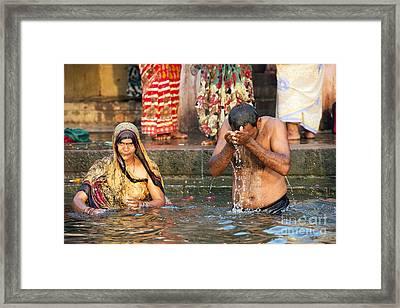 Bathing In The Ganges Framed Print by Tony Camacho