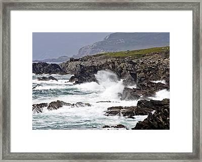Battered Coast Framed Print by Tony Reddington