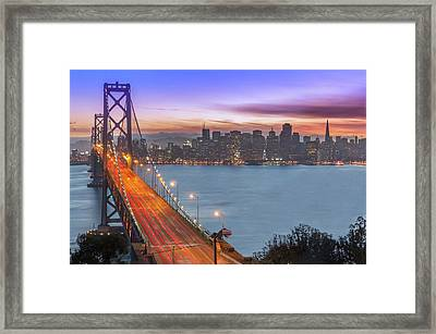 Bay Bridge And San Francisco Skyline At Framed Print by Spondylolithesis