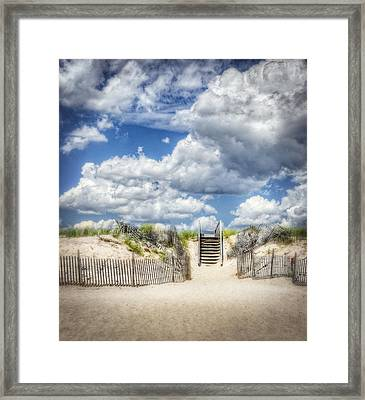 Beach Clouds And Fence Framed Print by Vicki Jauron