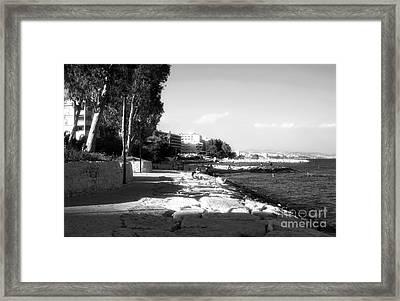 Beach Day At Limassol Framed Print by John Rizzuto