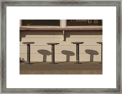 Beach Diner Stools Framed Print by Art Block Collections