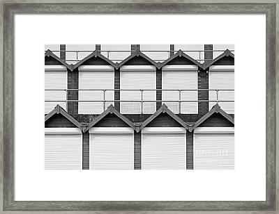 Beach Hut Plaza Framed Print by Richard Thomas