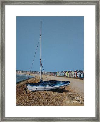 Beach Huts And Boat On The Spit Framed Print by Linda Monk