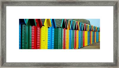 Beach Huts Framed Print by Chris Whittle