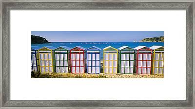 Beach Huts In A Row On The Beach Framed Print