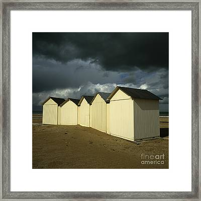 Beach Huts Under A Stormy Sky In Normandy. France. Europe Framed Print by Bernard Jaubert