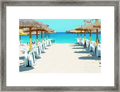 Beach Parasols And Loungers Framed Print