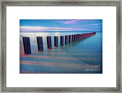 Beach Pylons At Sunset Framed Print by Martin Konopacki