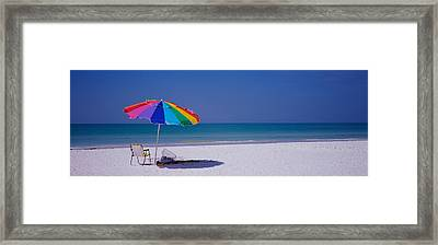 Beach Umbrella And A Folding Chair Framed Print by Panoramic Images