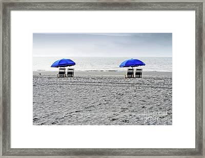 Beach Umbrellas On A Cloudy Day Framed Print