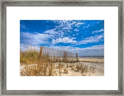 Beach Under Blue Skies Framed Print by Debra and Dave Vanderlaan