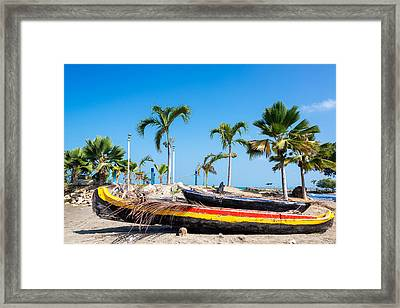 Beached Canoes Framed Print