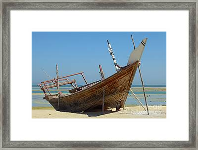 Beached Dhow At Wakrah Framed Print by Paul Cowan
