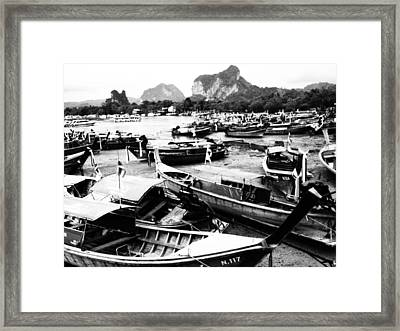 Beached Longboats Framed Print by Justin Woodhouse