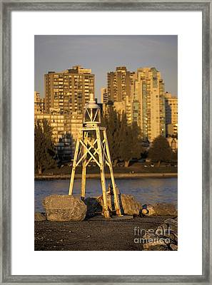 Beacon And Skyscrapers In Vancouver Canada Framed Print by Ryan Fox
