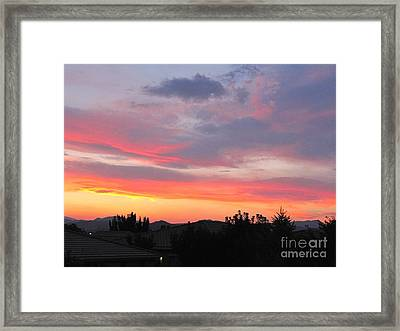 Beautiful And Downright Eerie Sunset Framed Print by Phyllis Kaltenbach