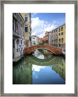 Beautiful Reflections Of Bridge In Canal In Venice Italy Framed Print