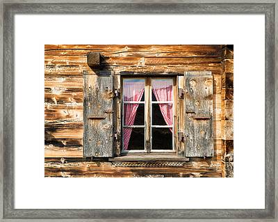 Beautiful Window Wooden Facade Of A Chalet In Switzerland Framed Print