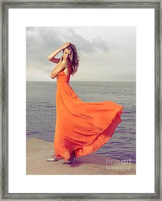 Beautiful Woman In Orange Dress On Sea Shore Framed Print by Oleksiy Maksymenko