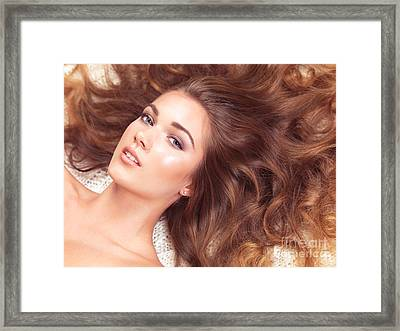 Beautiful Woman With Long Hair Spread Around Her Framed Print