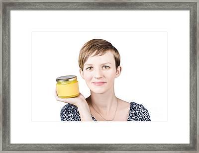 Beautiful Young Woman Displaying Jar Of Ghee Framed Print