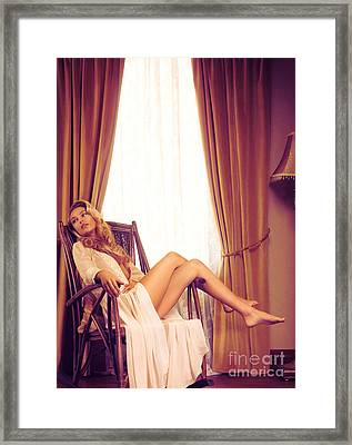 Beautiful Young Woman In A Rocking Chair By The Window Framed Print by Oleksiy Maksymenko