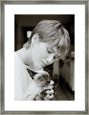 Beauty And The Cat Framed Print