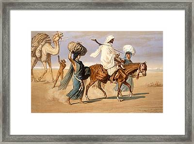 Bedouin Family Travels Across The Desert Framed Print