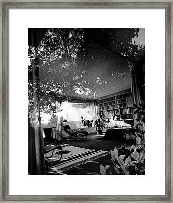 Bedroom Seen Through Glass From The Outside Framed Print