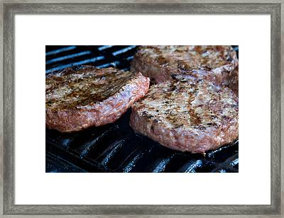 Beef Quarterpounder Burgers Begin To Cook On The Gas Barbecue Framed Print by Fizzy Image