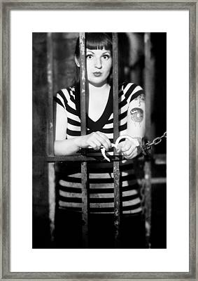 Framed Print featuring the photograph Behind Bars by Jim Poulos