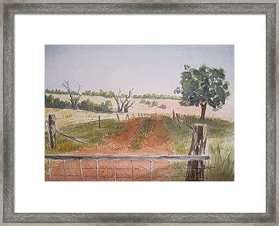 Behind The Gate Framed Print