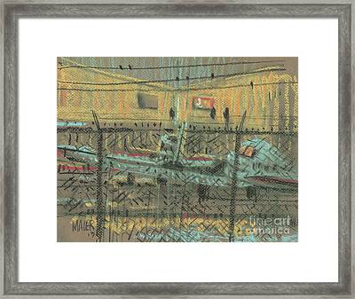 Behind The Fence Framed Print by Donald Maier