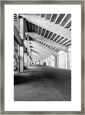 Behind The Grandstand Framed Print