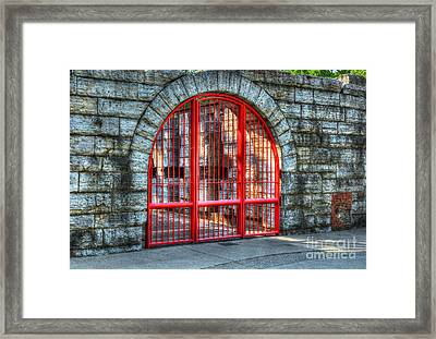 Behind The Red Gate Framed Print
