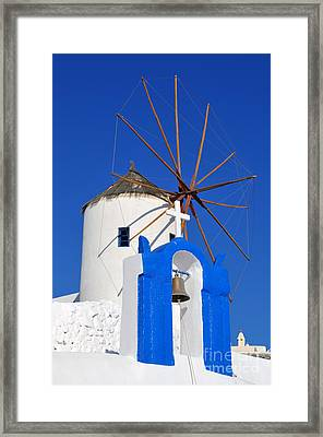 Belfry And Windmill In Oia Town Framed Print by George Atsametakis