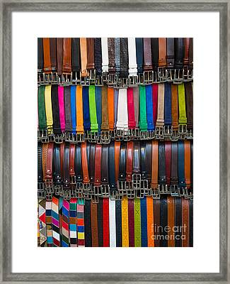 Belts Galore Framed Print by Inge Johnsson