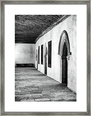 Bench At The End Of The Hall Framed Print by John Rizzuto