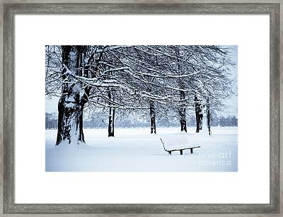 Bench In Snow Framed Print