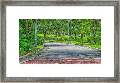 Bend In The Road Framed Print by Dennis Dugan