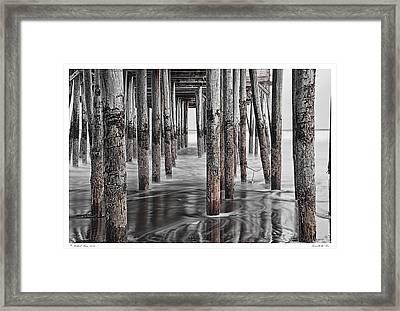 Beneath The Pier Framed Print by Richard Bean