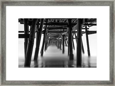 Beneath The Pier Framed Print