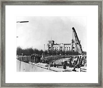 Berlin Wall Construction Framed Print by Underwood Archives