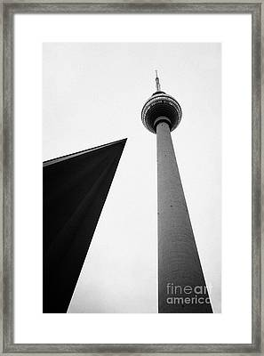 berliner fernsehturm Berlin TV tower symbol of east berlin with the roof of the nearby pavilion Germany Framed Print