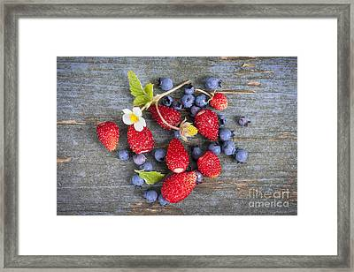Berries On Rustic Wood  Framed Print by Elena Elisseeva